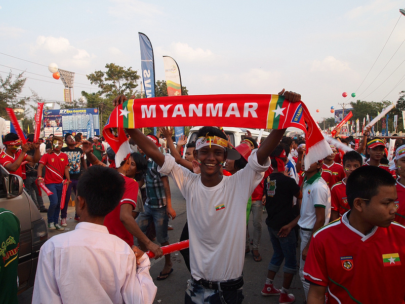 Supporters of Myanmar's soccer team rally on the road to the stadium prior to the Myanmar vs. Thailand match. Source:  William's flickr photostream, used under a creative commons license.
