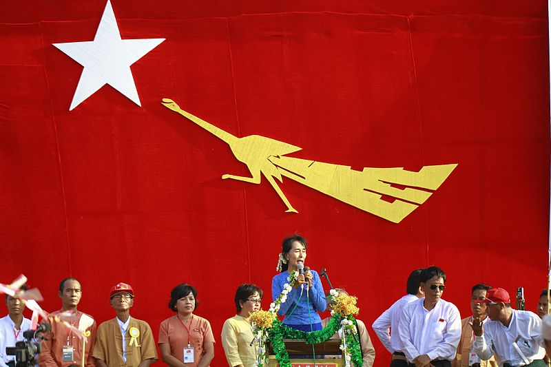 Aung San Suu Kyi delivers a speech to her supporters in her constituency Kawhmu township, Myanmar. Political  jockeying for power in Myanmar's 2015 elections has begun in earnest. Source: Wikimedia user, Htoo Tay Zar, used under a creative commons license.