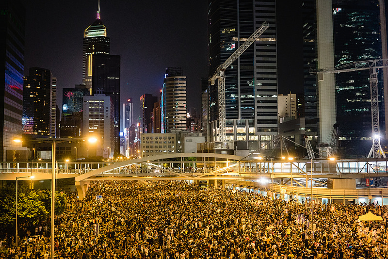 Thousands of peaceful protestors occupy the streets in Hong Kong, China on September, 29, 2014. Source: Pasuay @ incendo's flickr photostream, used under a creative commons license.